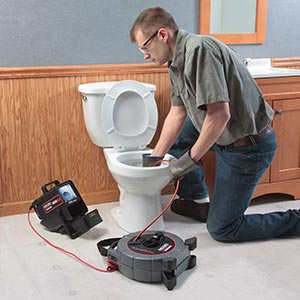 Jerry is using a Ridgid video camera to inspect a toile drain