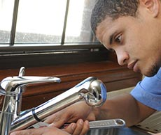 Loyd, one of our Kirkland plumbers is repairing a kitchen sink