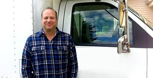Flinn is one of our Kirkland plumbing contractors and he stands ready by his truck