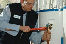 Mark is repairing a water heater